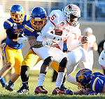 SIOUX FALLS, SD - NOVEMBER 7:  Dallas Brown #15 from South Dakota State University wraps up Tre Roberson #5 from Illinois State in the first half Saturday in the final game at Coughlin Alumni Stadium in Brookings. (Photo by Dave Eggen/Inertia)