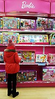 Pictured: A young girl browses in the Barbie section of the Toys R Us store in Swansea, Wales, UK. Wednesday 28 February 2018<br /> Re: Toys R Us have announced that they are in administration by Moorfields.