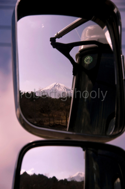 Mt Fuji is reflected in the mirrors of a truck parked near the head of a  trail that takes trekkers through parts of the Asagiri Plateau, with almost uninterrupted views of Mt Fuji, in Shizuoka Prefecture Japan on 22 March 2013.  Photographer: Robert Gilhooly