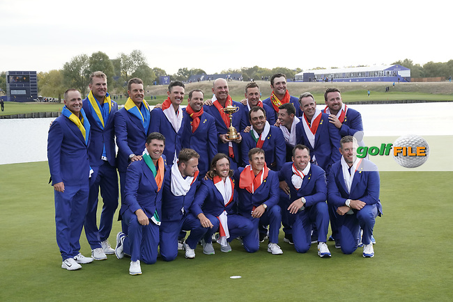 Team Europe celebrating on the 18th green after winning back the Ryder cup at Le Golf National, Iles-de-France, France. 30/09/2018.<br /> Picture Claudio Scaccini / Golffile.ie<br /> <br /> All photo usage must carry mandatory copyright credit (© Golffile | Claudio Scaccini)