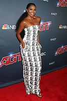 """LOS ANGELES - AUG 27:  Gabrielle Union wearing a dress with Dwayne Wade's baby picture on it at the """"America's Got Talent"""" Season 14 Live Show Red Carpet at the Dolby Theater on August 27, 2019 in Los Angeles, CA"""