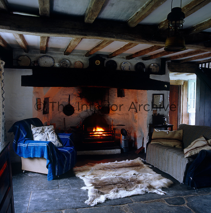A large inglenook fireplace dominates one end of the living room