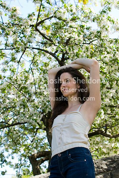 Woman standing under flowering tree