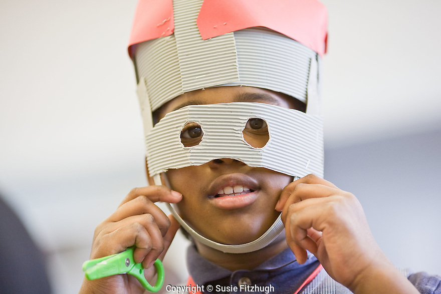 In Lauren Atkinson's Arts Corps class at St. Therese School, a student shows off her mask.