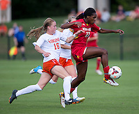 Emily Sonnett (16) of Virginia fights for the ball with Hayley Brock (27) of Maryland during the game at Klockner Stadium in Charlottesville, VA.  Virginia defeated Maryland, 1-0.