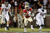 TALLAHASSEE, FL 11/19/11-FSU-UVA111911 CH-Florida State's Jermaine Thomas makes a 27 yard run as Virginia's Cam Johnson persues during first half action Saturday at Doak Campbell Stadium in Tallahassee. .COLIN HACKLEY PHOTO