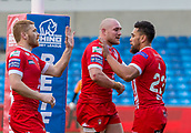 10th February 2019, AJ Bell Stadium, Salford, England; Betfred Super League rugby, Salford Red Devils versus London Broncos; Ken Sio of Salford Red Devils is congratulated by Gil Dudson and Kris Welham