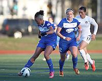Boston Breakers forward Lianne Sanderson (10) passes the ball. Boston Breakers forward Katie Schoepfer (12). In a National Women's Soccer League Elite (NWSL) match, the Boston Breakers (blue) tied the Washington Spirit (white), 1-1, at Dilboy Stadium on April 14, 2012.