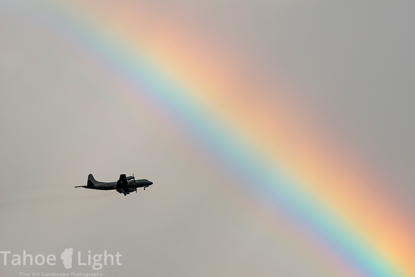 Rainbow over the airport in Hilo as planes com in for landings.