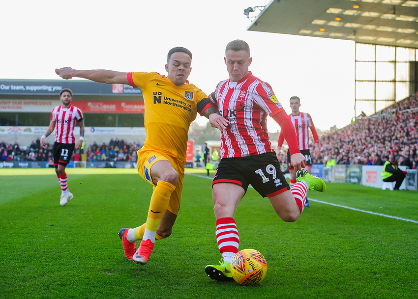 Lincoln City's Danny Rowe vies for possession with Northampton Town's Shay Facey<br /> <br /> Photographer Chris Vaughan/CameraSport<br /> <br /> The EFL Sky Bet League Two - Lincoln City v Northampton Town - Saturday 9th February 2019 - Sincil Bank - Lincoln<br /> <br /> World Copyright © 2019 CameraSport. All rights reserved. 43 Linden Ave. Countesthorpe. Leicester. England. LE8 5PG - Tel: +44 (0) 116 277 4147 - admin@camerasport.com - www.camerasport.com