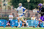 Los Angeles, CA 02/15/14 - Matt Kelly (UCLA #22) and Rem Baumann (Washington #6) in action during the Washington versus UCLA  game as part of the 2014 Pac-12 Shootout at UCLA.  UCLA defeated Washington 13-7.