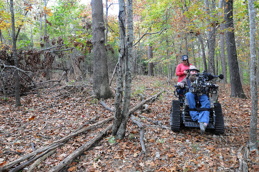 NWA Democrat-Gazette/FLIP PUTTHOFF <br /> A trip to the deer hunting blind is rough and bumpy    Oct. 26 2016 even with Steve's all-terrain chair.