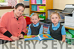 Class teacher Anne Marie Wrenn with her new junior infants Ive Cahill and Sophie Griffin Creagh on their first day of school at Meentogues NS last Monday.