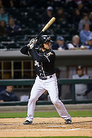 Kevan Smith (32) of the Charlotte Knights at bat against the Toledo Mud Hens at BB&T BallPark on April 27, 2015 in Charlotte, North Carolina.  The Knights defeated the Mud Hens 7-6 in 10 innings.   (Brian Westerholt/Four Seam Images)