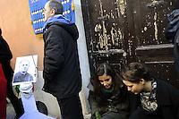 Roma 9 Gennaio 2012..Via Urbana.Memorie d'Inciampo a Roma..L'abitazione di don Pietro Pappagallo, sacerdote ucciso alle fosse ardeatine..Sampietrini rivestiti d'una placca d'ottone lucente incastonati a terra di fronte ai portoni di deportati e vittime del nazismo. L'idea è dell'artista tedesco Gunther Demnig nell'ambito del progetto «Memorie d'Inciampo a Roma» che prevede in vari Municipi il posizionamento di pietre , ciascuna dedicata ad un deportato per ragioni razziali, politiche e militari, di fronte alle loro abitazioni..Alcuni studenti hanno partecipato all'evento.Covered cobblestones of a shiny brass plaque embedded in the ground in front of the gates of deportees and victims of Nazism. The artist Gunther Demnig provides in various municipalities placement of stones, each dedicated to a deported for racial, political and military, in front of their houses.