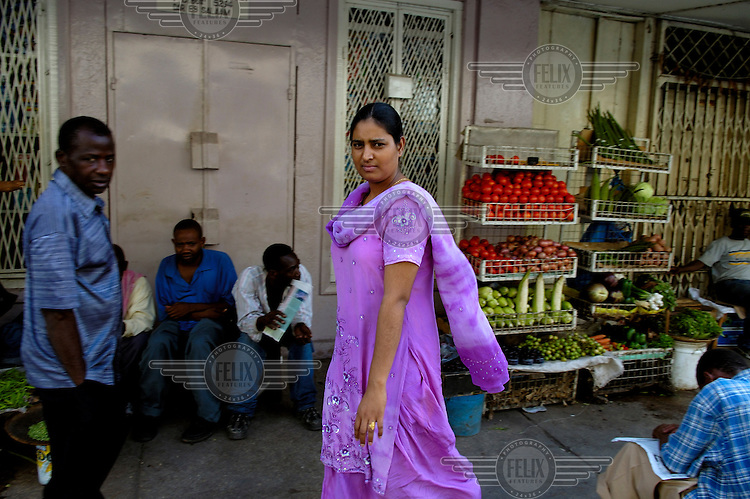 Indian woman on Zanaki Street in the downtown area known as Little India. The long-standing Indian community is part of the commercial backbone of Tanzania's largest city.