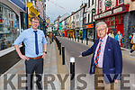 Cllr Donal Grady and pharmacist Eoin Reen say the new bollards are affecting business in Plunkett Street Killarney
