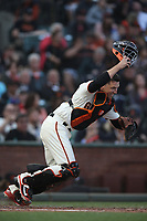 SAN FRANCISCO, CA - AUGUST 11:  Buster Posey #28 of the San Francisco Giants chases a bunt against the Pittsburgh Pirates during the game at AT&T Park on Saturday, August 11, 2018 in San Francisco, California. (Photo by Brad Mangin)