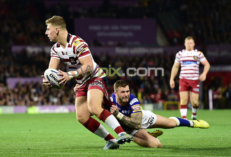 Picture by Alex Broadway/SWpix.com - 10/10/2015 - Rugby League - First Utility Super League Grand Final - Leeds Rhinos v Wigan Warriors - Old Trafford, Manchester, England - George Williams of Wigan Warriors is tackled by Zak Hardaker of Leeds Rhinos.