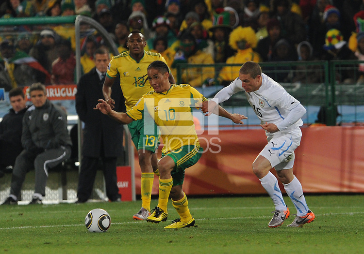 South African midfielder Steven Pienaar looks to get some separation from Diego Perez and build an attack towards the Uruguaian goal. Uruguay defeated South Africa, 2-0, in both teams' second match of play in Group A of the 2010 FIFA World Cup. The match was played at Loftus Versfeld in Pretoria, South Africa June 16th.