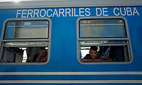 HAVANA, CUBA - JULY14: Passenger smiles before departing  in a new train at La Coubre station, from Havana to Santiago de Cuba, on July13, 2019. The first train start working for the cuban passenger to Santiago de Cuba, 516 miles. The new equipment made in China. (Photo by Eliana Aponte/VIEWpress)