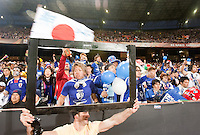 Carlo Zeurides of South Africa holds the frame for a Sony television in front of Japanese fans watching the action on the field.  Japan played Paraguay in a 2010 FIFA World Cup second round match at Loftus Versfeld Stadium in Tshwane/Pretoria, South Africa on Tuesday, June 29, 2010.