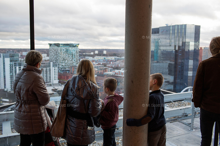 People look out at Birmingham, England, from the top floor of the new Birmingham Public Library.