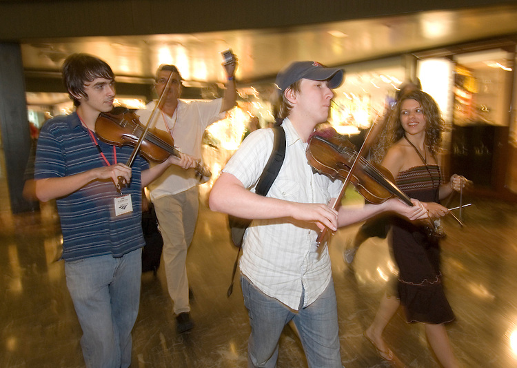 The band Feufollet plays cajun tunes as they make their way through Union Station after they arrived on Amtrak's Crescent train from New Orleans on Friday, Sept. 15, 2006. Artists from the gulf coast region were on a whistle stop tour, giving performances along the way, as they made their way to appear at the Kennedy Center's 22nd Annual Open House Arts Festival on Saturday, Sept. 16.