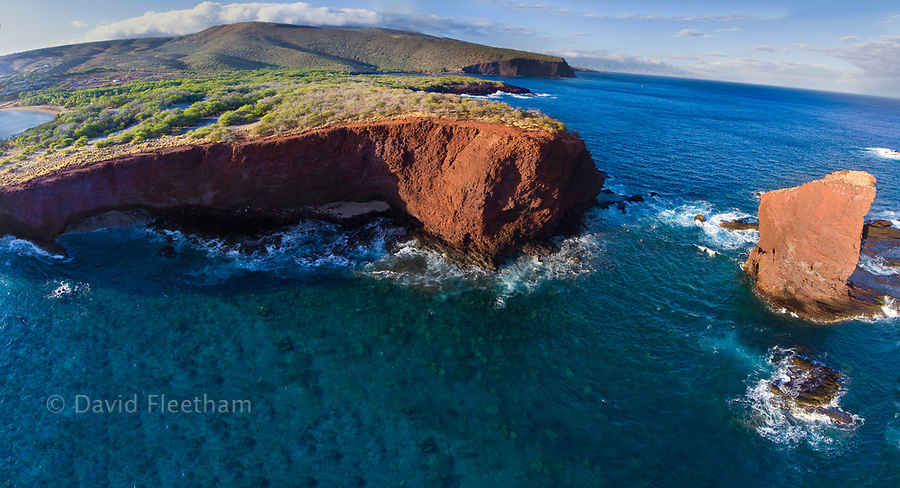 """An aerial view of Puu Pehe Rock at sunset, also known as """"Sweetheart Rock"""", one of Lanai's most recognizable landmarks, Lanai Island, Hawaii, USA."""