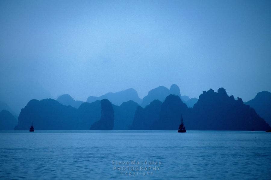 Mirage-like view of misty islands, Halong Bay, Vietnam