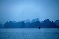 Mirage-like view of misty islands, Halong Bay, Vietnam