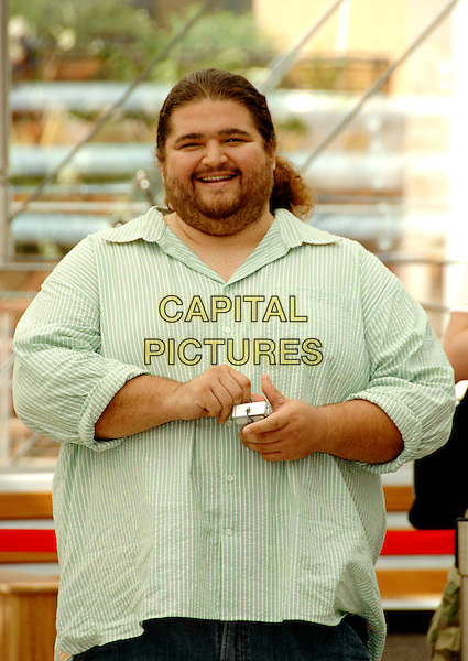 "JORGE GARCIA .Photocall promoting the television series ""Lost"" on the fourth day of the 2008 Monte Carlo Television Festival held at Grimaldi Forum, Monaco, Principality of Monaco..June 11th, 2008.half length green striped stripes shirt digital camera stubble facial hair .CAP/TTL .© TTL/Capital Pictures"