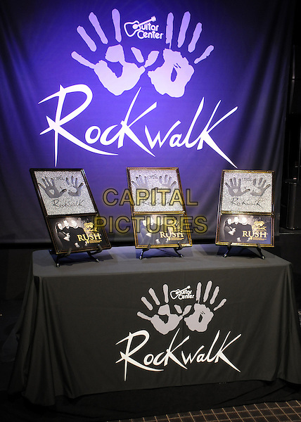 Rush handprints .Rush Induction into Guitar Center's Rockwalk held at Guitar Center Hollywood, Hollywood, California, USA..November 20th, 2012.gv general view plaque table .CAP/ADM/BP.©Byron Purvis/AdMedia/Capital Pictures.