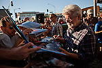 "Filmmaker George Lucas signs autographs before the American Graffiti Parade in Modesto, California, June 7, 2013. Modesto is celebrating the 40th anniversary of the film ""American Graffiti"", with a parade headed up by native son, filmmaker George Lucas."