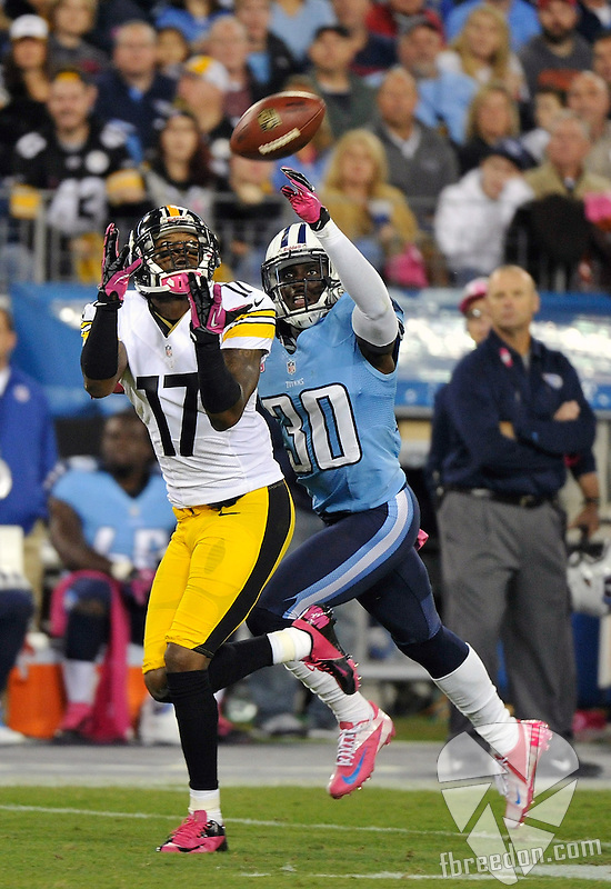 NASHVILLE, TN - OCTOBER 11:  Wide receiver Mike Wallace #17 of the Pittsburgh Steelers catches a touchdown pass over the outstretched arms of Jason McCourty #30 of the Tennessee Titans at LP Field on October 11, 2012 in Nashville, Tennessee.  (Photo by Frederick Breedon/Getty Images) *** Local Caption *** Mike Wallace; Jason McCourty