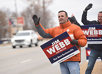 NWA Democrat-Gazette/FLIP PUTTHOFF <br />Jim Webb campaigns Tuesday Dec. 4 2018 along North Walton Boulevard in Bentonville.