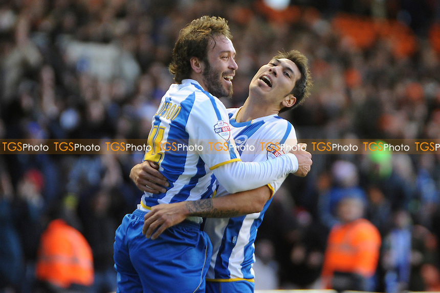 Inigo Calderon (left) of Brighton and Hove Albion celebrates scoring the opener with Leonardo Ulloa of Brighton and Hove Albion - Blackpool vs Brighton & Hove Albion - Sky Bet Championship Football at Bloomfield Road, Blackpool, Lancashire - 29/12/13 - MANDATORY CREDIT: Greig Bertram/TGSPHOTO - Self billing applies where appropriate - 0845 094 6026 - contact@tgsphoto.co.uk - NO UNPAID USE