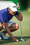 TAOYUAN, TAIWAN - OCTOBER 26:  Yani Tseng of Taiwan lines up a put on the 9th hole during the day two of the Sunrise LPGA Taiwan Championship at the Sunrise Golf Course on October 26, 2012 in Taoyuan, Taiwan. Photo by Victor Fraile / The Power of Sport Images