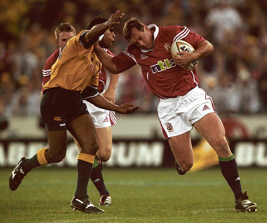 Photo. Richard Lane. .Lions Tour 2001 to Australia. Second Test at the Colonial Stadium, Melbourne, Australia. 7/7/2001.Richard Hill hands off Andrew Walker.