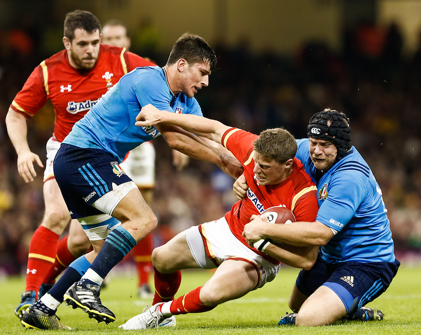 Wales' Rhys Priestland is tackled by Italy's Dario Chistolini<br /> <br /> Photographer Simon King/CameraSport<br /> <br /> International Rugby Union - RBS 6 Nations Championships 2016 - Wales v Italy - Saturday 19th March 2016 - Principality Stadium, Cardiff <br /> <br /> &copy; CameraSport - 43 Linden Ave. Countesthorpe. Leicester. England. LE8 5PG - Tel: +44 (0) 116 277 4147 - admin@camerasport.com - www.camerasport.com