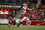 Wisconsin Badgers kicker Philip Welch (18) kicks off during an NCAA college football game against the Ohio State Buckeyes on October 16, 2010 at Camp Randall Stadium in Madison, Wisconsin. The Badgers beat the Buckeyes 31-18. (Photo by David Stluka)
