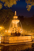 Beautiful night image of fountain and color in Parque Central Plaza in tourist village of  Antigua Guatemal
