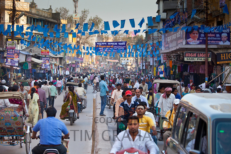 Crowded street scene during holy Festival of Shivaratri in city of Varanasi, Benares, Northern India