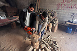 Palestinian lumberjacks cut and prepares firewood for sale and production of charcoal at a workshop, Gaza City, on February 26, 2019. Photo by Mahmoud Ajjour