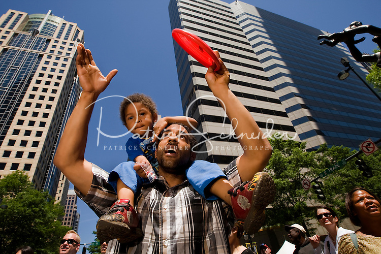 A father and son enjoy the festivities Food Lion Speed Street in uptown Charlotte, NC.
