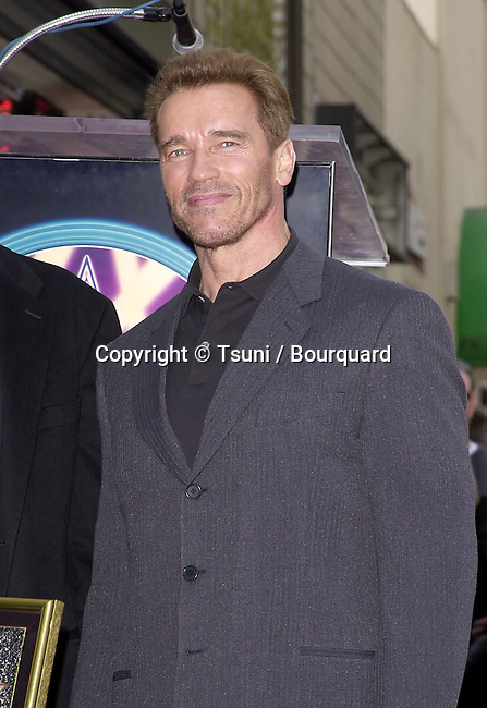 Arnold Schwarzenegger attenting the ceremony of Stan Winston receiving the 2173rd star on Hollywood blvd. in Los Angeles  02/23/01<br />           -            SchwarzeneggerArnold30.jpg