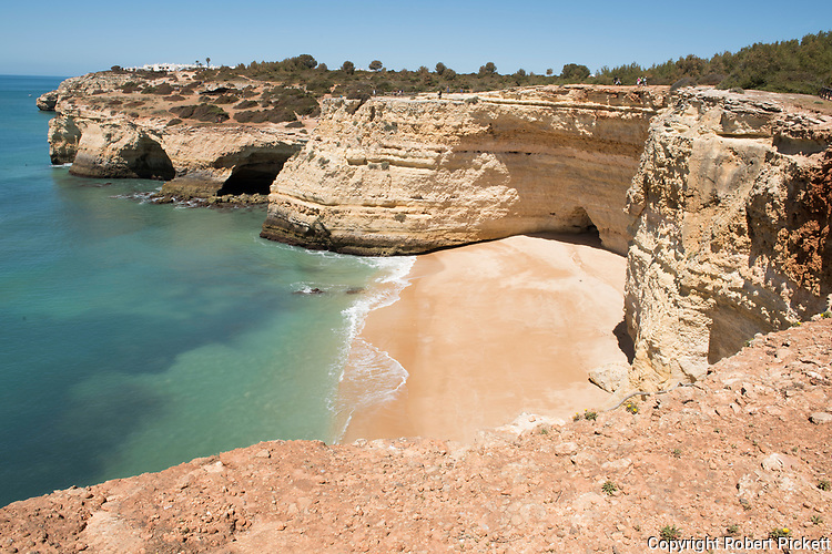 Secluded beach and cliffs near Carvoeiro town, Algarve, Portugal