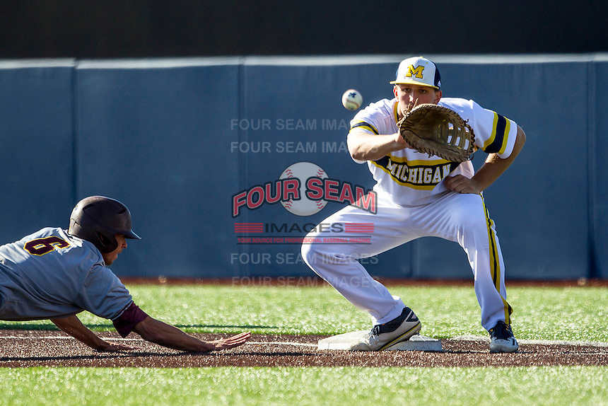 Michigan Wolverines first baseman Carmen Benedetti (43) catches a pickoff attempt against the Central Michigan Chippewas on March 29, 2016 at Ray Fisher Stadium in Ann Arbor, Michigan. Michigan defeated Central Michigan 9-7. (Andrew Woolley/Four Seam Images)