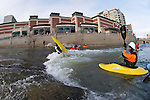 World champion junior kayaker Jason Craig of Reno, NV, loops in hole, practices as other local kayakers look on at the whitewater park on the Truckee River in downtown Reno, NV