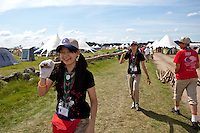 Japanese scouts fetching building material for their camp. Photo: Kim Rask/Scouterna
